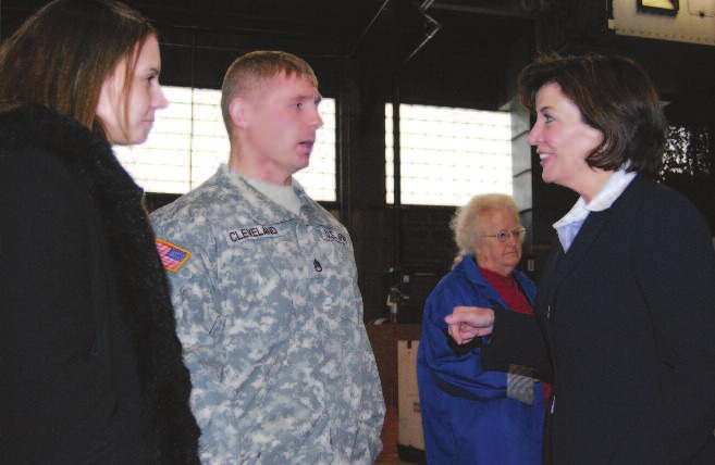 U.S. Rep. Kathy Hochul speaks with Staff Sgt. Steven Cleveland and his wife, Sherry, both of Clarence.