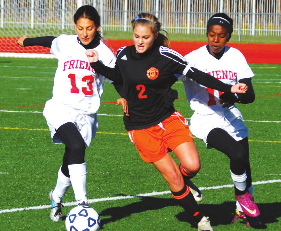 Keshequa sophomore Haley Russell muscles her way ahead of Quakers Melissa Greenblatt and Alexis Toles. Russell scored the second of the Indians goals on the morning.