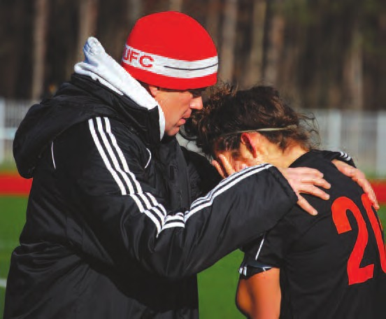 Coach Pete Goho consoles emotional captain and senior Gabby DiAngelo after the team's only loss of the season ended Keshequa's hopes of a state title. In a 3-2 semifinal loss against Friends Academy, the Indians allowed as many goals as they did in the previous 21 games.