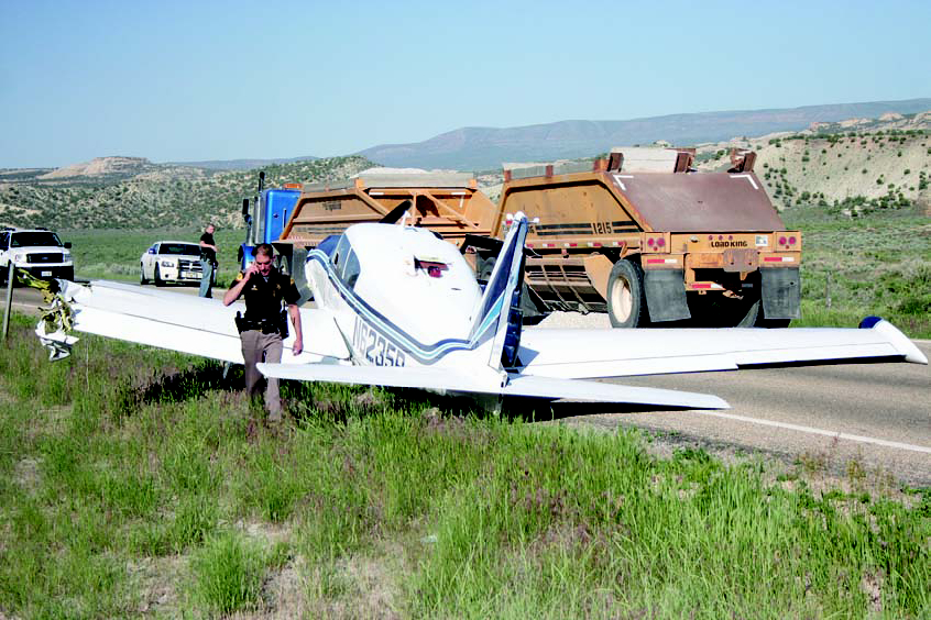 Utah Highway Patrol Trooper Jon Gardiner documents damage to an airplane after the pilot made an emergency landing on U.S. Highway 191 and collided with a truck hauling gravel. The incident restricted traffic north of Vernal Wednesday morning until after 10 a.m. The National Transportation Safety Board's investigation report into the landing has not been released.
